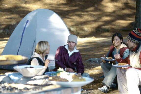 Campers Having a Meal Together